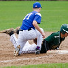 Lunenburg's Connor Palma checks Oakmont's Zach Batten back to first during the game on Friday afternoon. SENTINEL & ENTERPRISE / Ashley Green