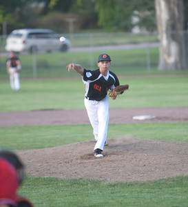 Connor Merrill pitches during their game against Alliance on Monday