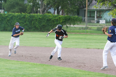 Alec Fox is caught in a pickle between first and second base against Alliance on Monday