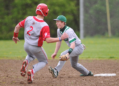 Red Jacket's #2 steals second before Naples second baseman #2 can make a tag attempt.  Photo by Jack Haley for Daily Messenger.