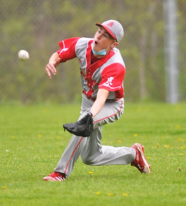 Red Jacket centerfielder #11 makes a big catch for the Indians on Monday. Photo by Jack Haley for Daily Messenger.