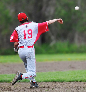 Red Jacket shortstop #19 fires to first base. Photo by Jack Haley for Daily Messenger.