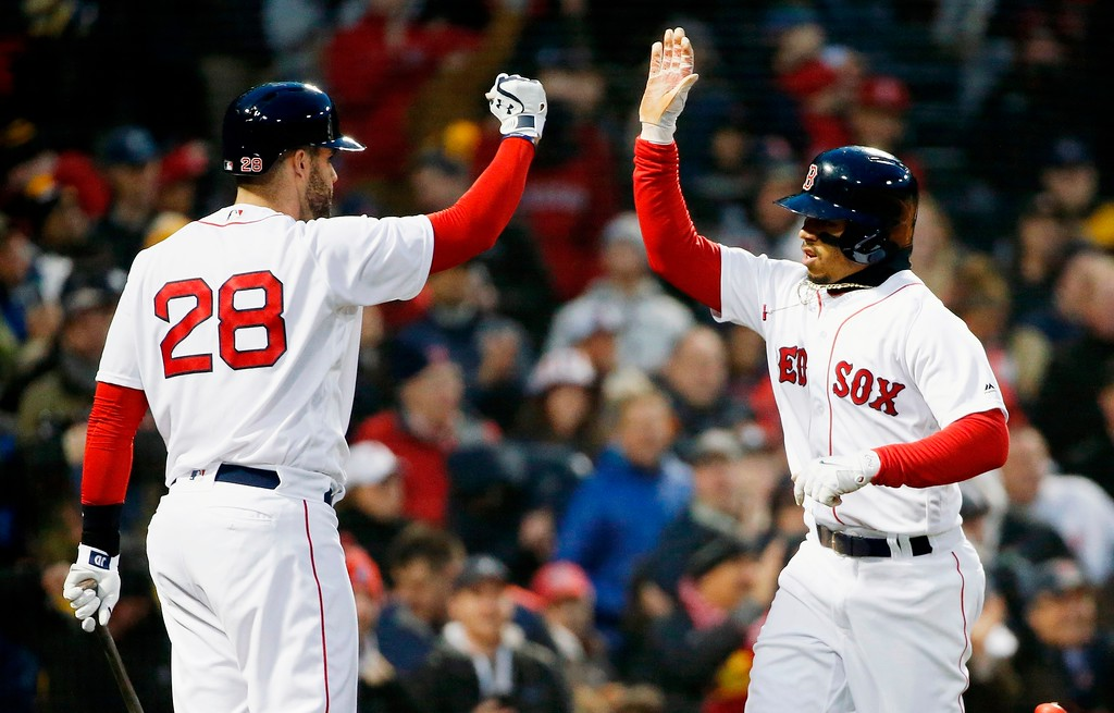 . Boston Red Sox\'s Mookie Betts, right, celebrates with J.D. Martinez (28) after scoring on a single by Hanley Ramirez during the first inning of the team\'s baseball game against the New York Yankees in Boston, Tuesday, April 10, 2018. (AP Photo/Michael Dwyer)