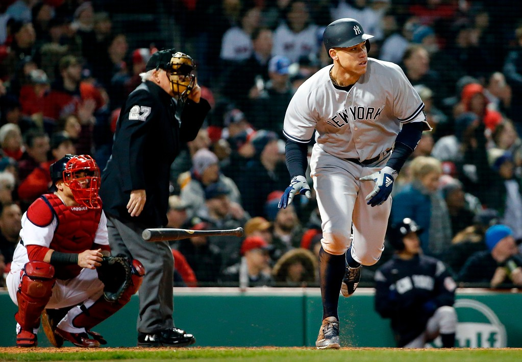 . New York Yankees\' Aaron Judge heads to first with a solo home run during the fifth inning of a baseball game against the Boston Red Sox in Boston, Tuesday, April 10, 2018. (AP Photo/Michael Dwyer)