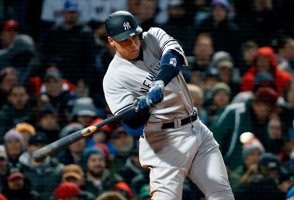 . New York Yankees\' Aaron Judge hits a solo home run during the fifth inning of a baseball game against the Boston Red Sox in Boston, Tuesday, April 10, 2018. (AP Photo/Michael Dwyer)