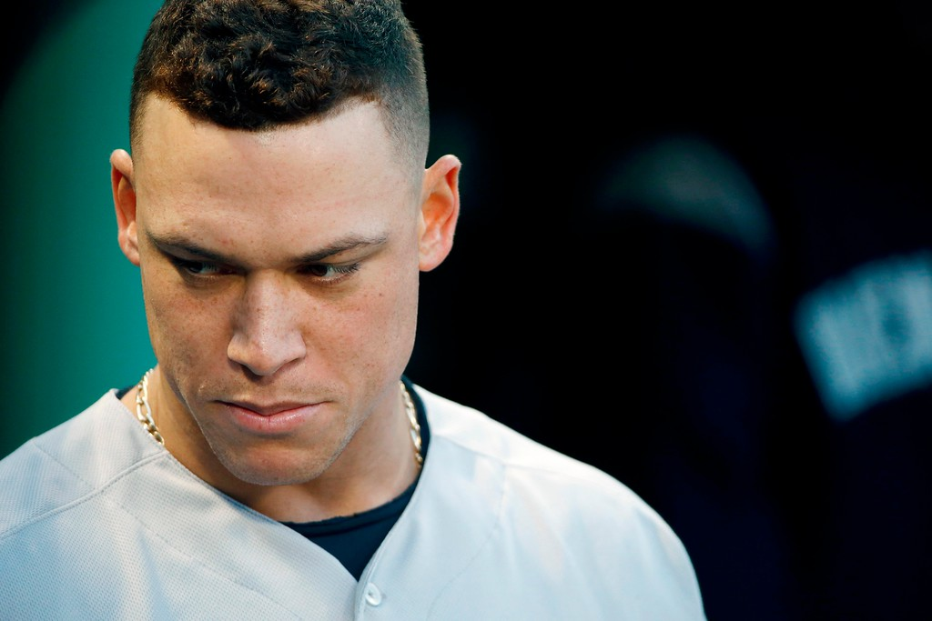 . New York Yankees\' Aaron Judge stands in the dugout before a baseball game against the Boston Red Sox in Boston, Tuesday, April 10, 2018. (AP Photo/Michael Dwyer)