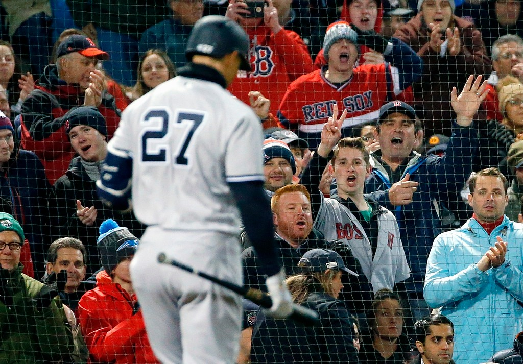 . New York Yankees\' Giancarlo Stanton walks to the dugout after striking out during the third inning of the team\'s baseball game against the Boston Red Sox in Boston, Tuesday, April 10, 2018. (AP Photo/Michael Dwyer)