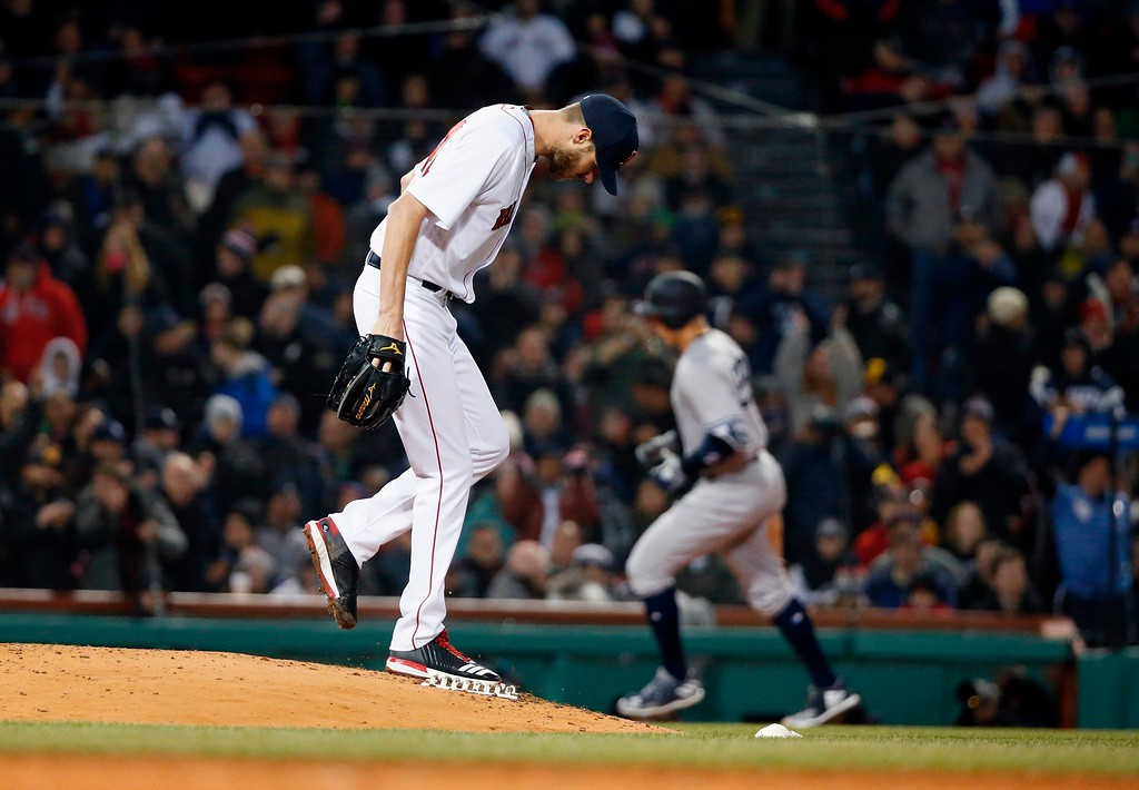 . Boston Red Sox\'s Chris Sale kicks the mound after giving up a solo home run to New York Yankees\' Aaron Judge, right, during the fifth inning of a baseball game in Boston, Tuesday, April 10, 2018. (AP Photo/Michael Dwyer)
