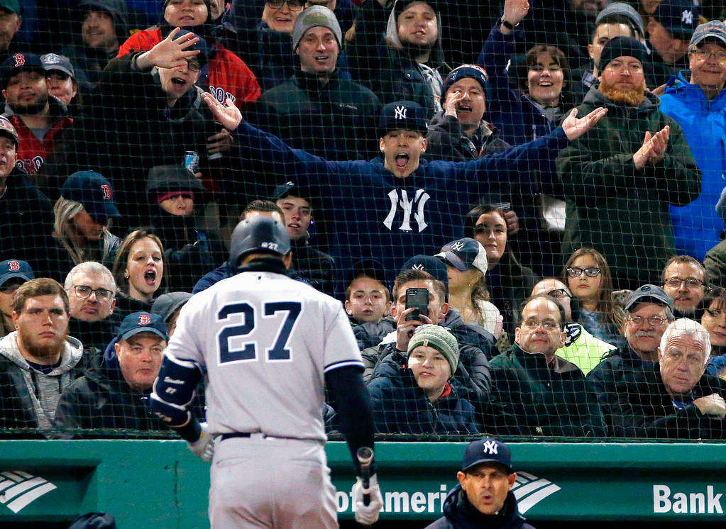 . New York Yankees\' Giancarlo Stanton walks to the dugout after striking out during the third inning of a baseball game against the Boston Red Sox in Boston, Tuesday, April 10, 2018. (AP Photo/Michael Dwyer)