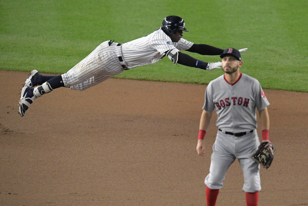 . New York Yankees\' Didi Gregorius dives into second base after connecting for a double against the Boston Red Sox during the fourth inning of Game 4 of baseball\'s American League Division Series, Tuesday, Oct. 9, 2018, in New York. (AP Photo/Bill Kostroun)