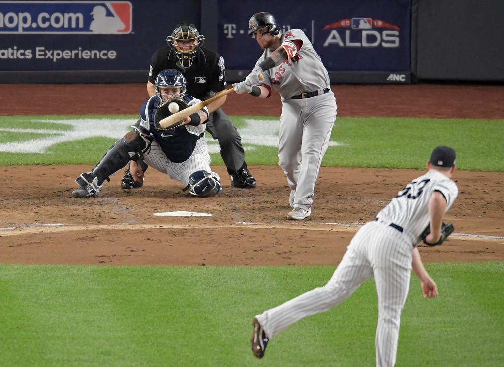 . Boston Red Sox\'s Christian Vazquez connects for a solo home run against the New York Yankees during the fourth inning of Game 4 of baseball\'s American League Division Series, Tuesday, Oct. 9, 2018, in New York. (AP Photo/Bill Kostroun)