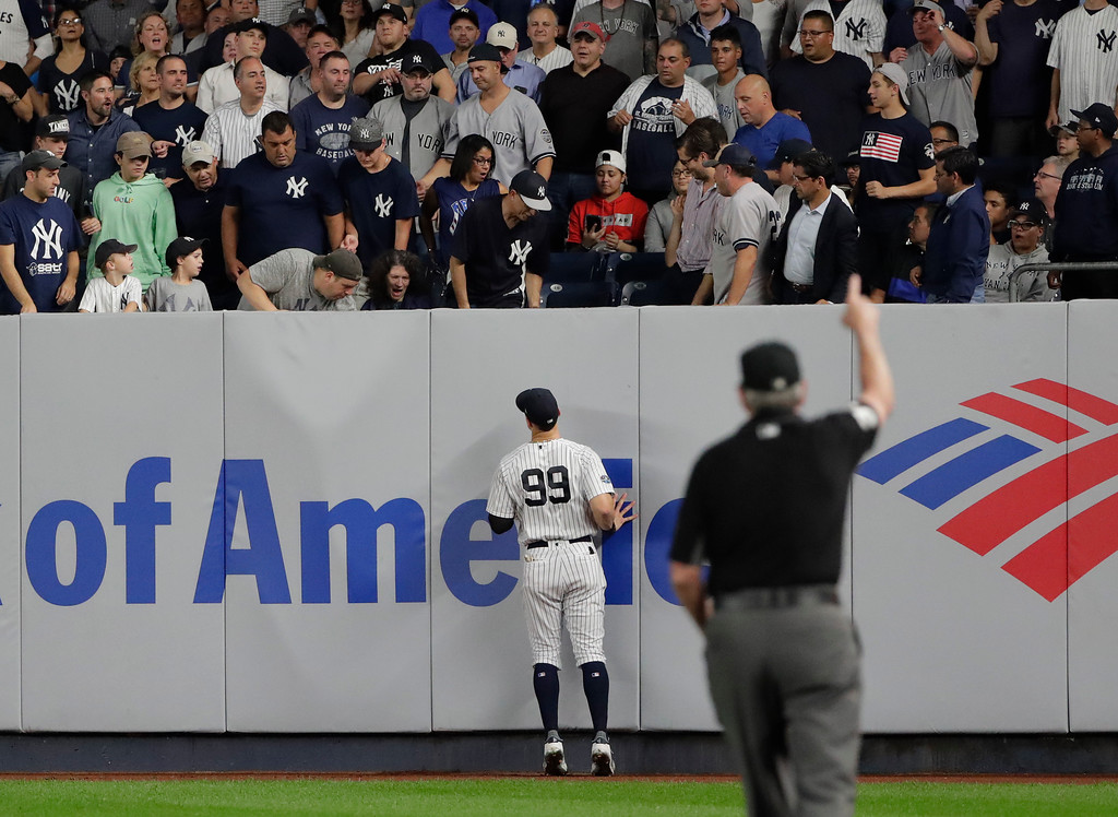 . New York Yankees right fielder Aaron Judge (99) watches as Boston Red Sox batter Christian Vazquez\'s ball lands over the right field wall for a solo home run during the fourth inning of Game 4 of baseball\'s American League Division Series, Tuesday, Oct. 9, 2018, in New York. (AP Photo/Frank Franklin II)