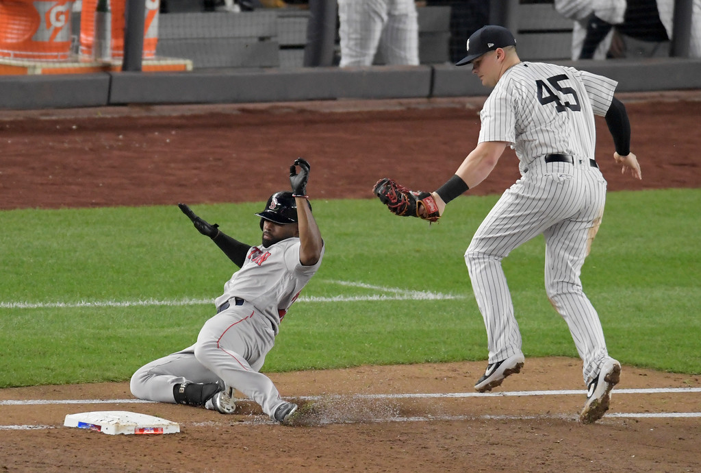 . New York Yankees first baseman Luke Voit (45) tags out Boston Red Sox\'s Jackie Bradley Jr. on ground ball by Bradley during the third inning of Game 4 of baseball\'s American League Division Series, Tuesday, Oct. 9, 2018, in New York. (AP Photo/Bill Kostroun)
