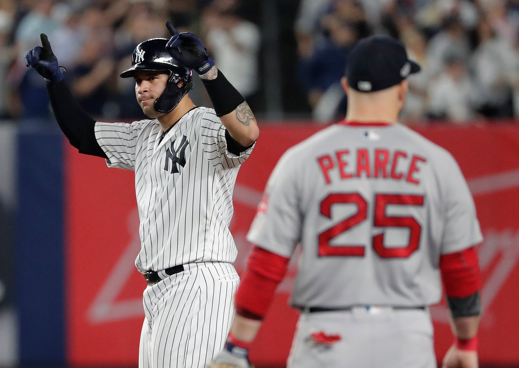 . New York Yankees\' Gary Sanchez motions to the dugout after doubling against the Boston Red Sox during the fifth inning of Game 4 of baseball\'s American League Division Series, Tuesday, Oct. 9, 2018, in New York. (AP Photo/Frank Franklin II)