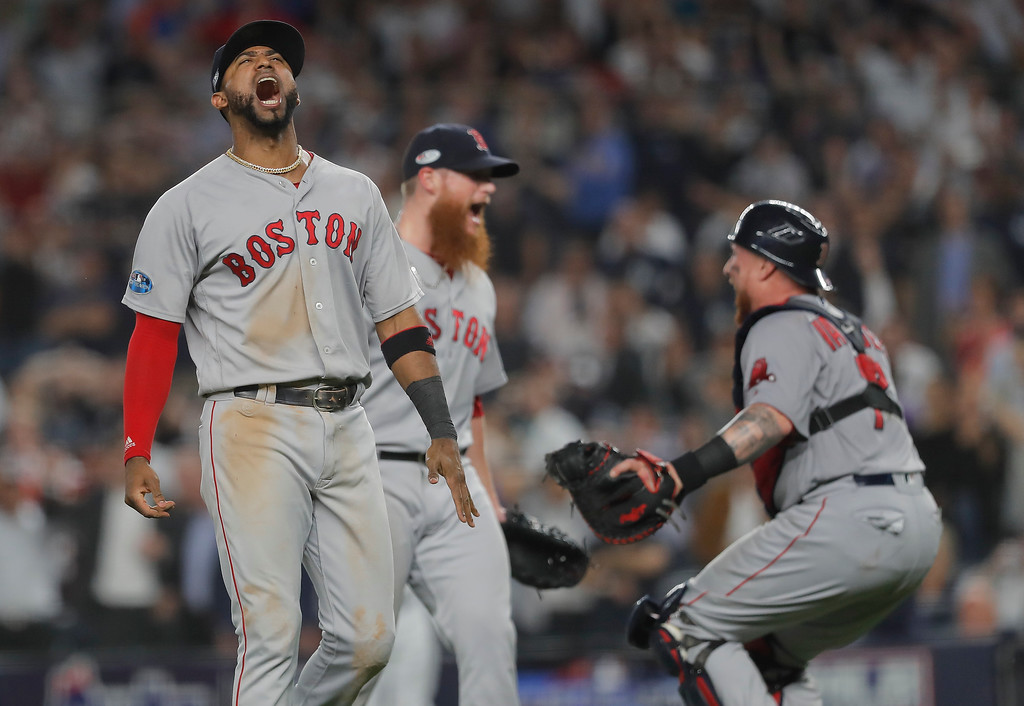 . Boston Red Sox third baseman Eduardo Nunez, left, celebrates with relief pitcher Craig Kimbrel, center, and catcher Christian Vazquez after the Red Sox beat the New York Yankees 4-3 in Game 4 of baseball\'s American League Division Series, Tuesday, Oct. 9, 2018, in New York. (AP Photo/Julie Jacobson)