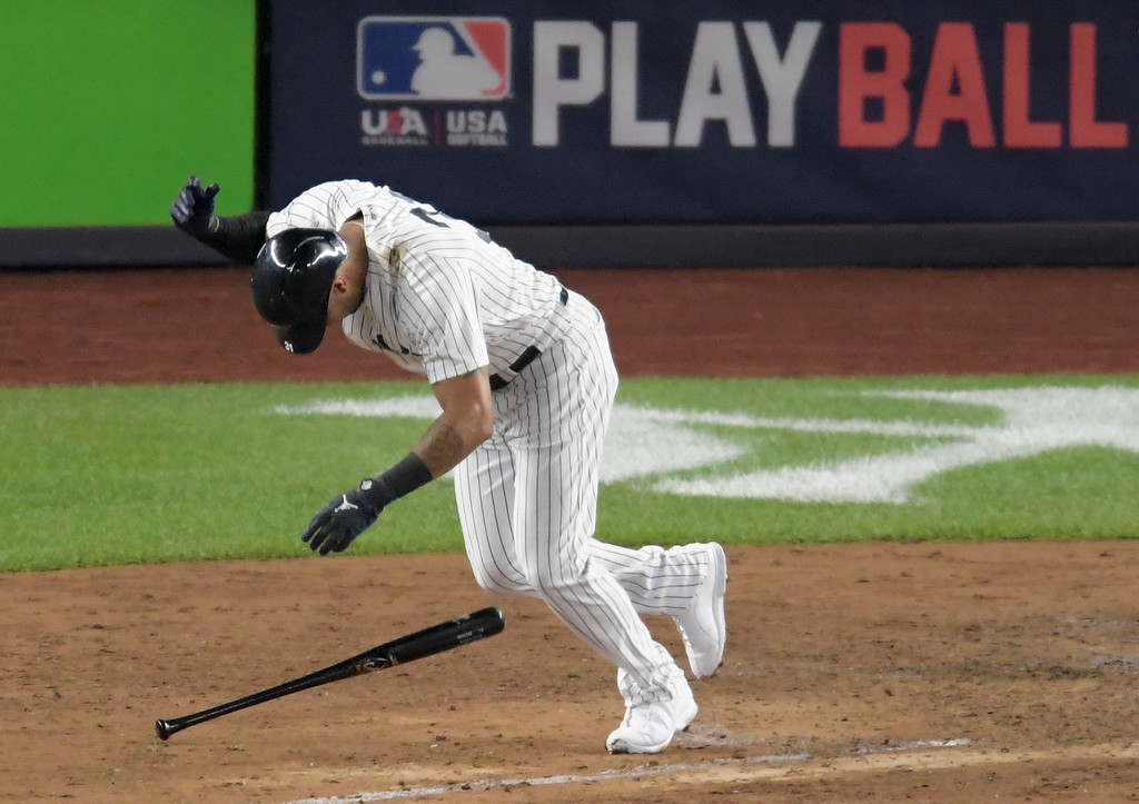 . New York Yankees\' Aaron Hicks reacts after popping out to end the fifth inning of Game 4 of baseball\'s American League Division Series against the Boston Red Sox, Tuesday, Oct. 9, 2018, in New York. (AP Photo/Bill Kostroun)