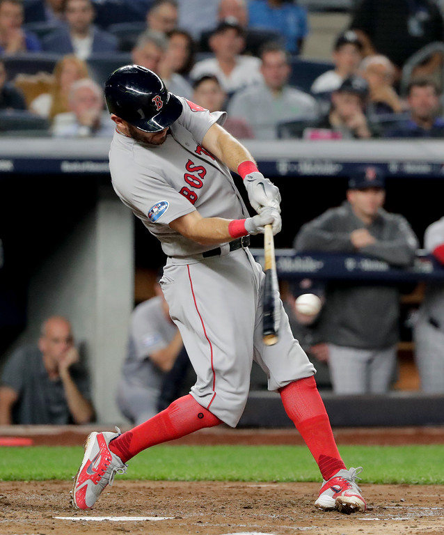. Boston Red Sox\'s J.D. Martinez connects for a sacrifice fly to drive in a run against the New York Yankees during the third inning of Game 4 of baseball\'s American League Division Series, Tuesday, Oct. 9, 2018, in New York. (AP Photo/Frank Franklin II)