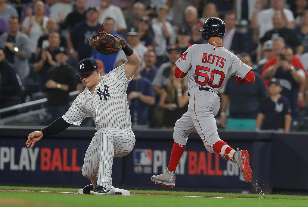 . New York Yankees first baseman Luke Voit (45) scoops up a throw into the dirt for the out on Boston Red Sox\'s Mookie Betts during the first inning of Game 4 of baseball\'s American League Division Series, Tuesday, Oct. 9, 2018, in New York. (AP Photo/Julie Jacobson)
