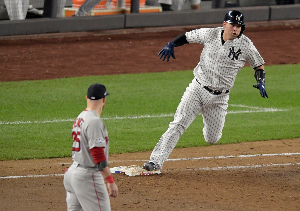 . New York Yankees\' Gary Sanchez rounds first base after connecting for a double against the Boston Red Sox during the fifth inning of Game 4 of baseball\'s American League Division Series, Tuesday, Oct. 9, 2018, in New York. (AP Photo/Bill Kostroun)