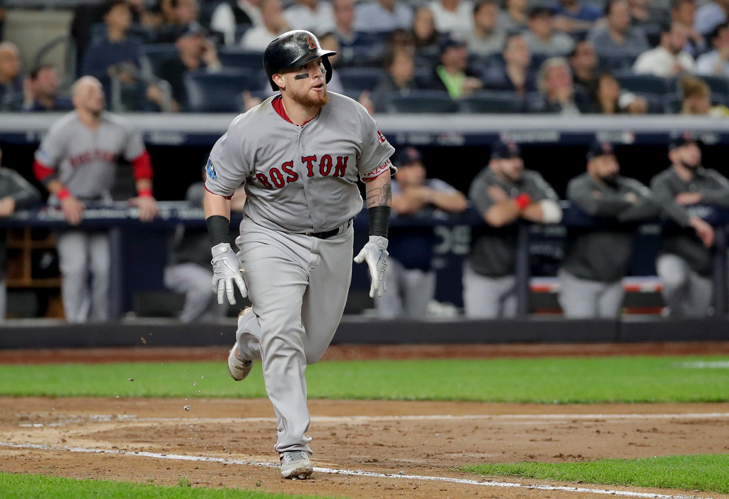 . Boston Red Sox\'s Christian Vazquez (7) heads down the first base line after connecting for a solo home run against the New York Yankees during the fourth inning of Game 4 of baseball\'s American League Division Series, Tuesday, Oct. 9, 2018, in New York. (AP Photo/Frank Franklin II)