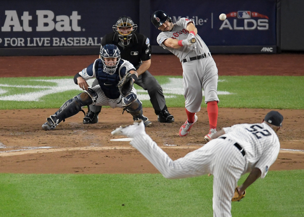 . Boston Red Sox\'s Ian Kinsler connects for an RBI double against the New York Yankees during the third inning of Game 4 of baseball\'s American League Division Series, Tuesday, Oct. 9, 2018, in New York. (AP Photo/Bill Kostroun)