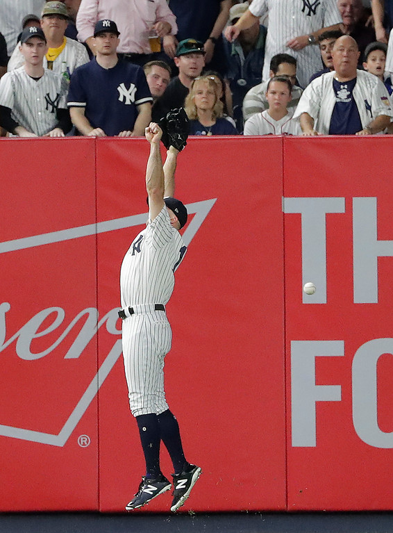 . New York Yankees left fielder Brett Gardner (11) can\'t make the catch on an RBI double by Boston Red Sox\'s Ian Kinsler during the third inning of Game 4 of baseball\'s American League Division Series, Tuesday, Oct. 9, 2018, in New York. (AP Photo/Frank Franklin II)