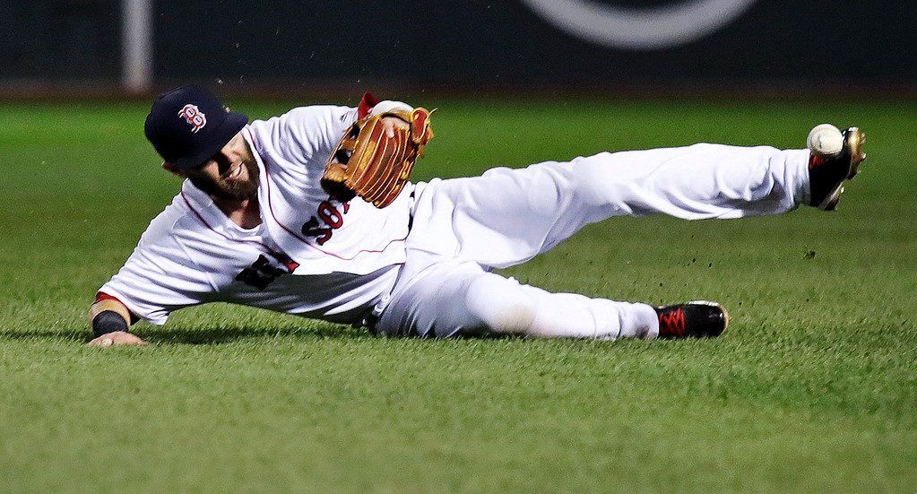 . Boston Red Sox second baseman Dustin Pedroia slides as he tries to make the play on a double by Toronto Blue Jays\'s Justin Smoak during the fifth inning of a baseball game at Fenway Park in Boston, Tuesday, July 18, 2017. (AP Photo/Charles Krupa)