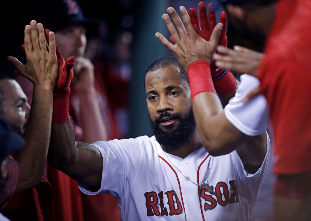 . Boston Red Sox\'s Chris Young is congratulated by teammates after his solo home run off Toronto Blue Jays starting pitcher J.A. Happ during the fourth inning of a baseball game at Fenway Park in Boston, Tuesday, July 18, 2017. (AP Photo/Charles Krupa)