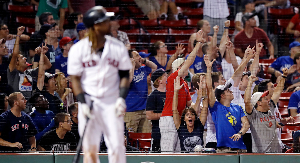 . Fans celebrate as Boston Red Sox\'s Hanley Ramirez watches his game-winning solo home run during the 15th inning of the team\'s baseball game against the Toronto Blue Jays at Fenway Park in Boston, early Wednesday, July 19, 2017. The Red Sox won 5-4. (AP Photo/Charles Krupa)