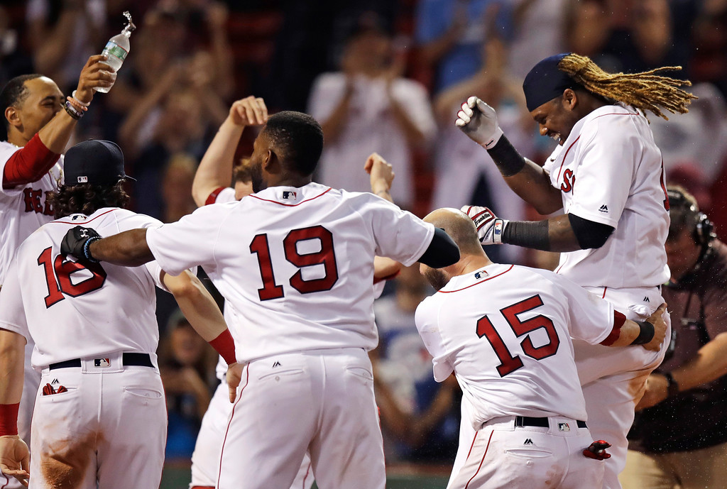 . Boston Red Sox\'s Hanley Ramirez, right, is welcomed by teammates after his game-winning solo home run during the 15th inning of the team\'s baseball game against the Toronto Blue Jays at Fenway Park in Boston, early Wednesday, July 19, 2017. The Red Sox won 5-4. (AP Photo/Charles Krupa)