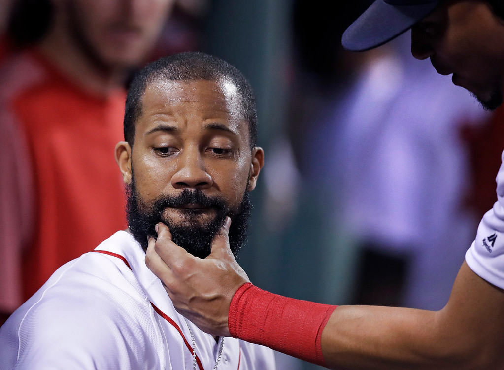 . Boston Red Sox\'s Chris Young has his beard tugged by Xander Bogaerts as he is congratulated after his solo home run off Toronto Blue Jays starting pitcher J.A. Happ during the fourth inning of a baseball game at Fenway Park in Boston, Tuesday, July 18, 2017. (AP Photo/Charles Krupa)