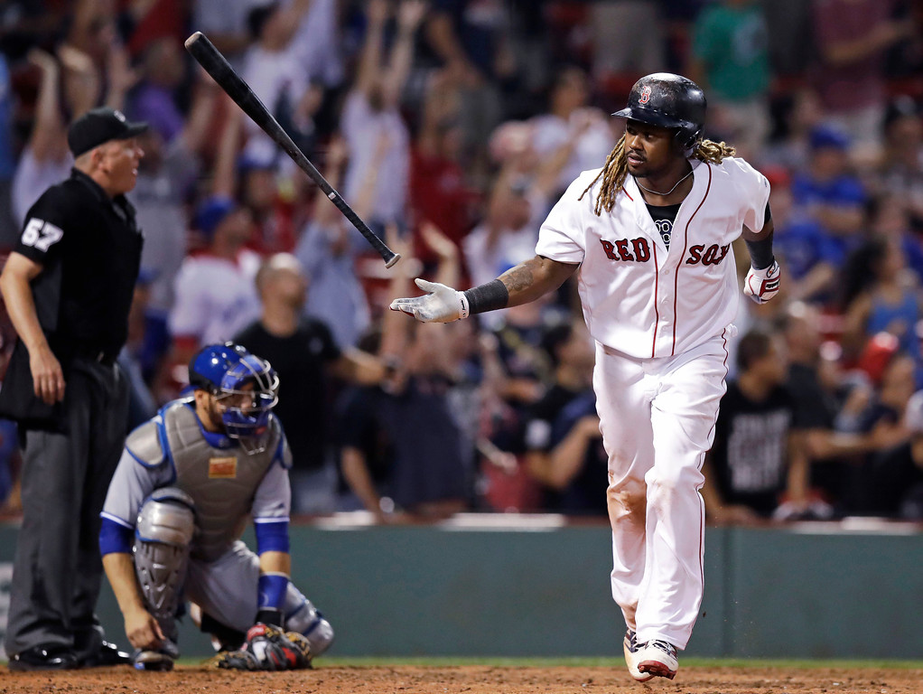 . Boston Red Sox\'s Hanley Ramirez flips his bat after his game-winning solo home run during the 15th inning of the team\'s baseball game against the Toronto Blue Jays at Fenway Park in Boston, early Wednesday, July 19, 2017. The Red Sox won 5-4. (AP Photo/Charles Krupa)