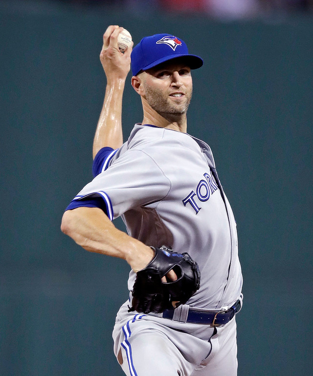 . Toronto Blue Jays starting pitcher J.A. Happ delivers during the first inning of a baseball game against the Boston Red Sox at Fenway Park in Boston, Tuesday, July 18, 2017. (AP Photo/Charles Krupa)