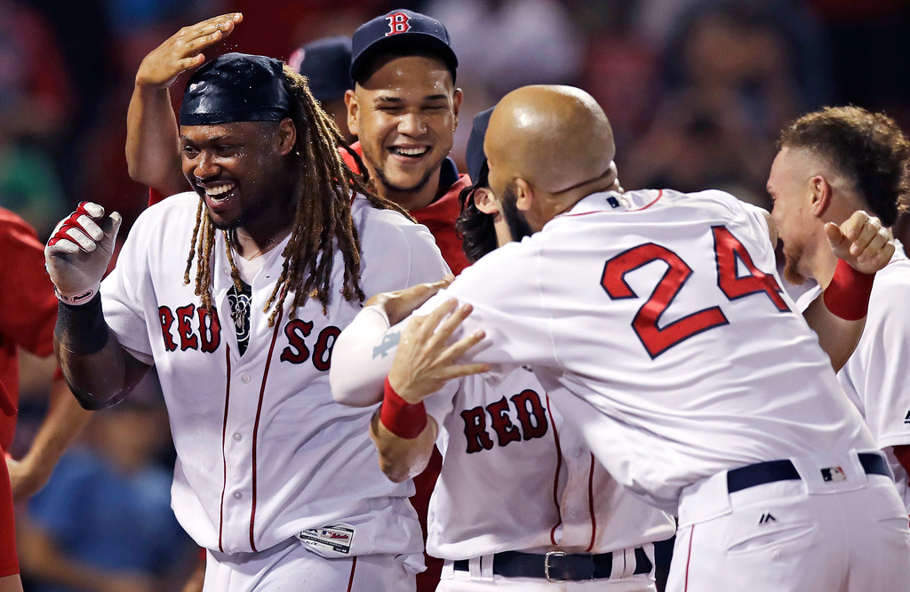 . Boston Red Sox\'s Hanley Ramirez, left, celebrates with teammates after his game-winning solo home run during the 15th inning against the Toronto Blue Jays in a baseball game at Fenway Park in Boston, early Wednesday, July 19, 2017. The Red Sox won 5-4. (AP Photo/Charles Krupa)