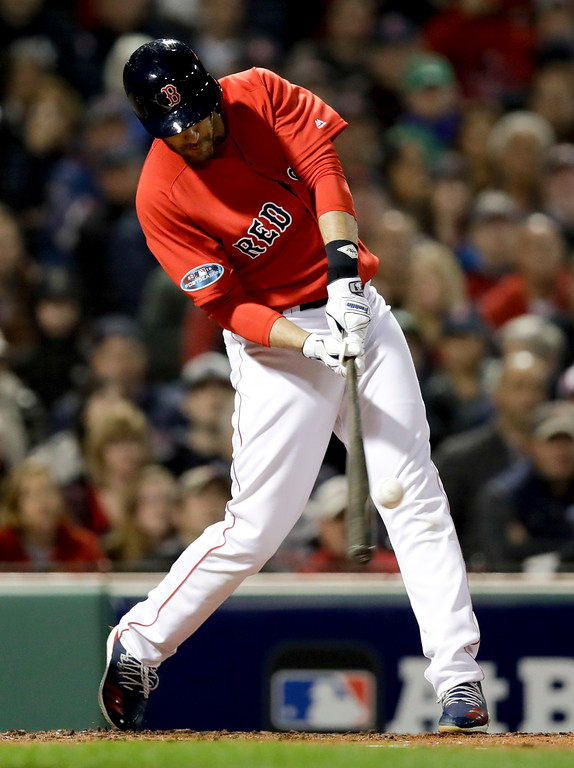 . Boston Red Sox\'s J.D. Martinez hits a three-run home run during the first inning of Game 1 of the baseball team\'s American League Division Series against the New York Yankees on Friday, Oct. 5, 2018, in Boston. (AP Photo/Charles Krupa)