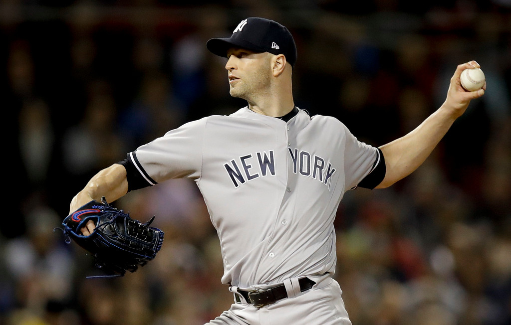 . New York Yankees starting pitcher J.A. Happ throws to a Boston Red Sox batter during the first inning of Game 1 of a baseball American League Division Series on Friday, Oct. 5, 2018, in Boston. (AP Photo/Charles Krupa)