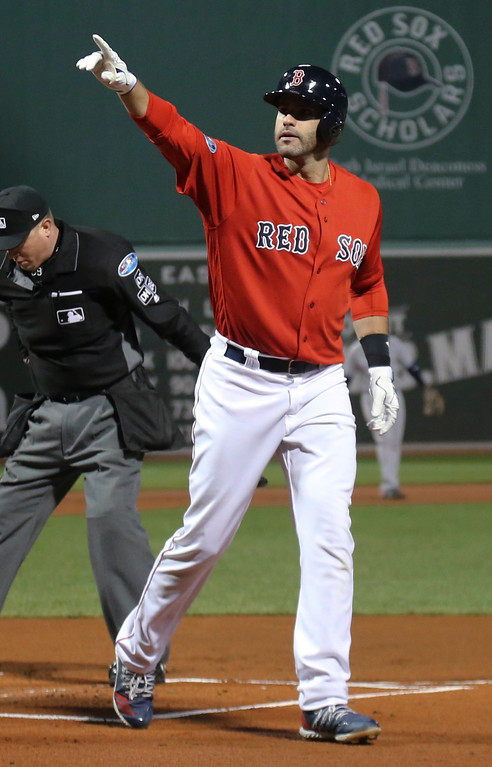 . Boston Red Sox\'s J.D. Martinez celebrates after his three-run home run during the first inning of Game 1 of a baseball American League Division Series against the New York Yankees on Friday, Oct. 5, 2018, in Boston. (AP Photo/Elise Amendola)