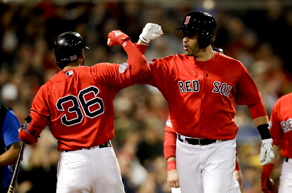 . Boston Red Sox\'s J.D. Martinez celebrates after his three-run home run with Eduardo Nunez during the first inning of Game 1 of a baseball American League Division Series against the New York Yankees on Friday, Oct. 5, 2018, in Boston. (AP Photo/Charles Krupa)