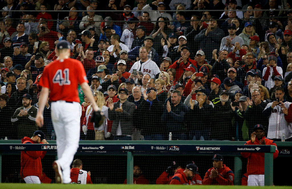 . Fans cheers as Boston Red Sox starting pitcher Chris Sale leaves the baseball game against the New York Yankees during the sixth inning of Game 1 of an American League Division Series on Friday, Oct. 5, 2018, in Boston. (AP Photo/Elise Amendola)