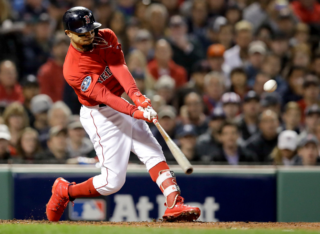 . Boston Red Sox\'s Mookie Betts hits a double against the New York Yankees during the third inning of Game 1 of a baseball American League Division Series on Friday, Oct. 5, 2018, in Boston. (AP Photo/Charles Krupa)
