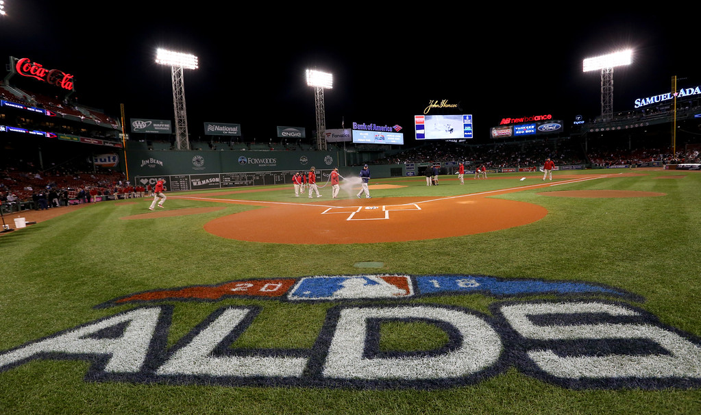. Members of the grounds crew ready the field before Game 1 of a baseball American League Division Series between the Boston Red Sox and the New York Yankees on Friday, Oct. 5, 2018, in Boston. (AP Photo/Elise Amendola)