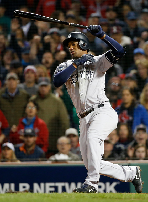 . New York Yankees\' Miguel Andujar strikes out swinging during the fourth inning against the Boston Red Sox in Game 1 of a baseball American League Division Series on Friday, Oct. 5, 2018, in Boston. (AP Photo/Elise Amendola)