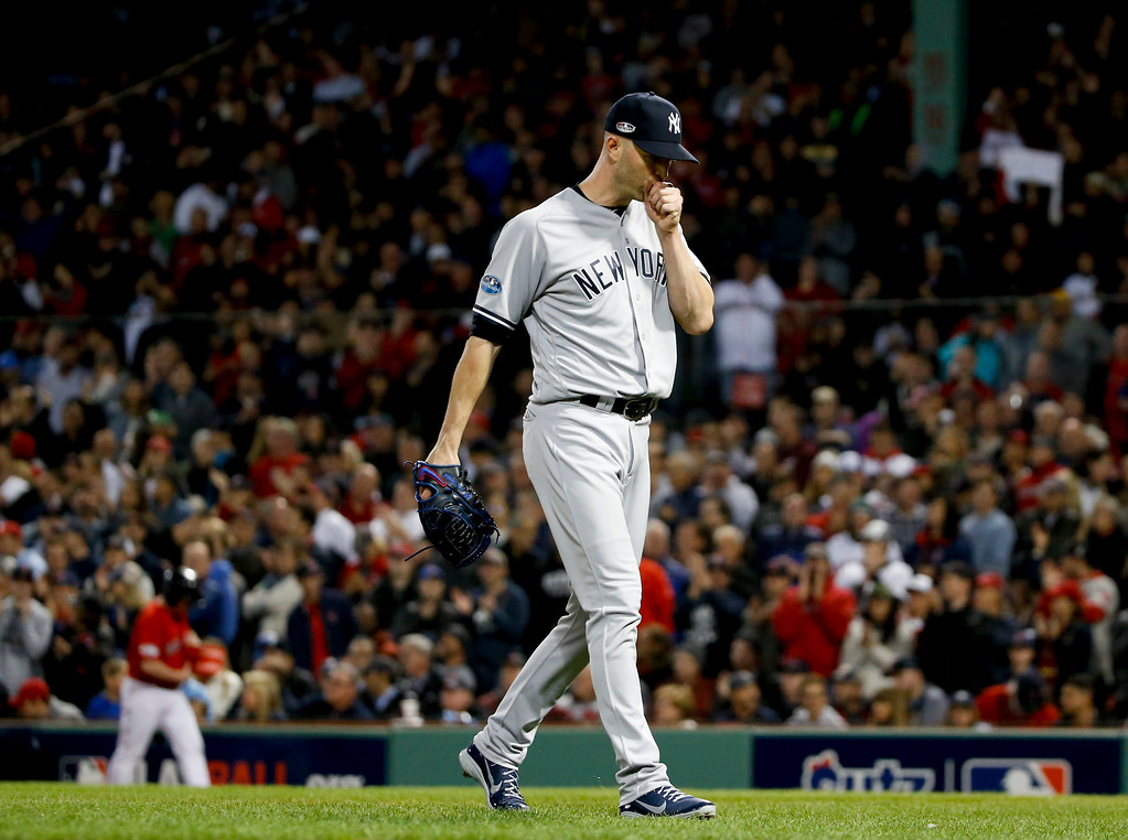 . New York Yankees starting pitcher J.A. Happ leaves during the third inning against the Boston Red Sox in Game 1 of a baseball American League Division Series on Friday, Oct. 5, 2018, in Boston. (AP Photo/Elise Amendola)