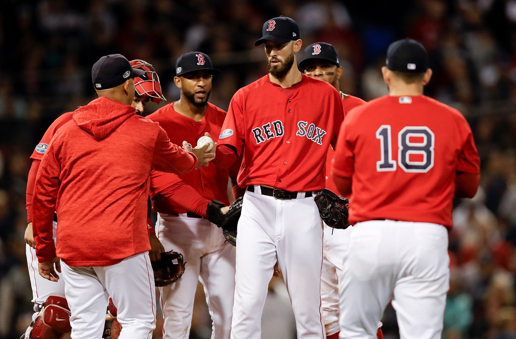 . Boston Red Sox pitcher Rick Porcello leave Game 1 against the New York Yankees during the eighth inning of an American League Division Series baseball matchup Friday, Oct. 5, 2018, in Boston. (AP Photo/Charles Krupa)