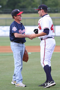 Congressman Phil Gingrey makes the first pitch at Monday night's Rome Braves Game_RuthAnne Anderson