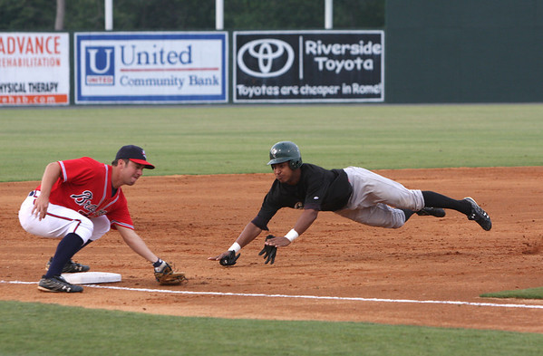 Savannah Sand Gnat #7 Greg Veloz attemps a dive into 3rd base, Rome Braves #10 Adam Coe tags him out. RA