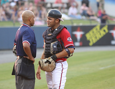 A little argument after a call between Home Plate Umpire and Rome Braves catcher Javier Dominguez
