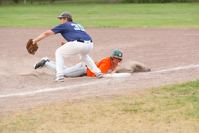 Jordan McCracken of Alliance on first base tries to tag out Leighton Freeze on the Express.