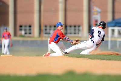Shikellamy's Kyle Leitzel slides past Selinsgrove's Ian Weaver at second base during Monday's game.