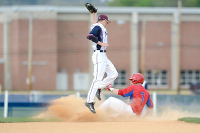 Selinsgrove's Zac Broome slides safely under Shikellamy's Hunter Dodge during Monday's game.